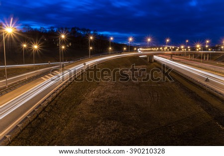 car light trails on motorway junction