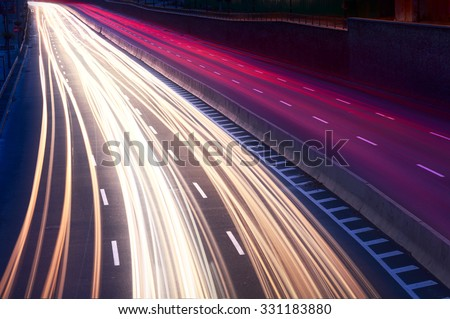 Car light trails on the city street at night. Long exposure photo