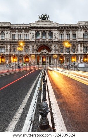 Car lights in the night front of the Palace of Justice in Rome, Italy - stock photo