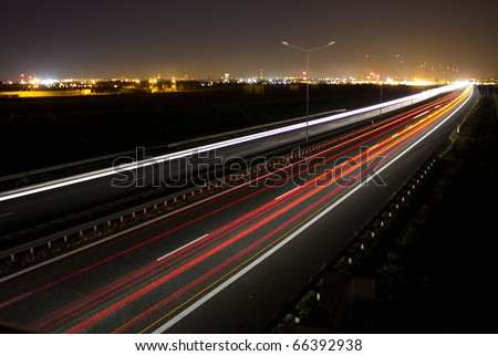 Car lights on a highway at night, long exposure photo of traffic - stock photo