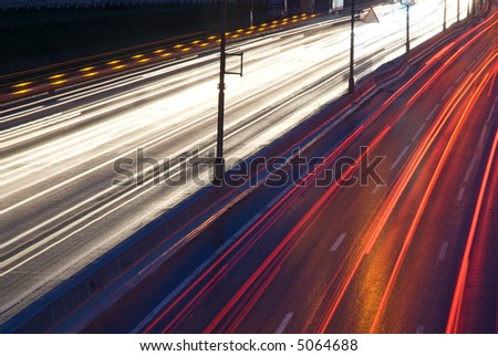 Car lights on highway - stock photo