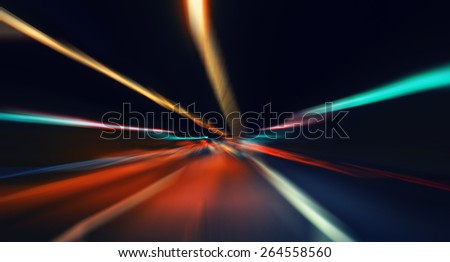 car lights on highway by night,abstract light speed trace,abstract speed background,light spectrum color - stock photo
