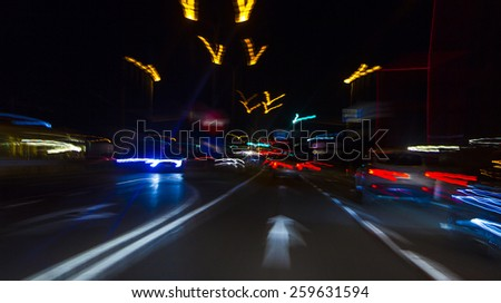 car lights on highway by night,abstract light trace background - stock photo