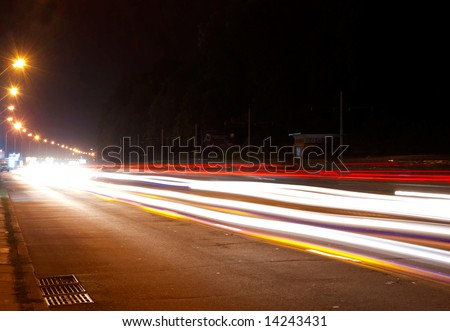 Car lights on highway in the night - stock photo