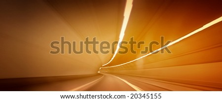 Car lights trails in a tunnel