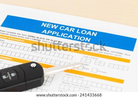 Car loan application with car key - stock photo