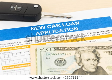 Car loan application with car key and dollar banknote - stock photo