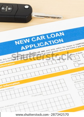 Car loan application with car key; form is mock-up