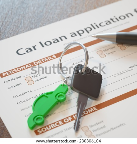 Car loan application with car keys and pen - stock photo