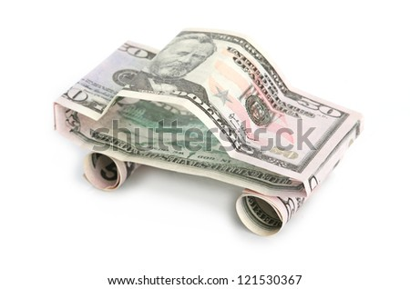 car made from dollar isolated on white background