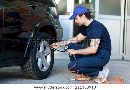 Car mechanic at work - stock photo