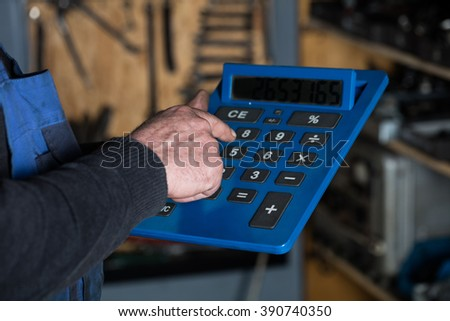 Car mechanic calculating price of work at auto repair workshop. Garage concept - stock photo