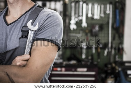 Car mechanic in garage - stock photo