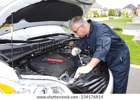 Car mechanic in uniform. Auto repair service. - stock photo