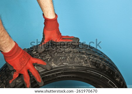 car mechanic with tires - stock photo