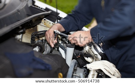 Car mechanic with wrench.
