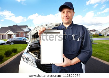 Car mechanic working in auto repair service. - stock photo
