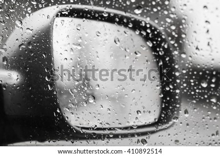 Car mirror, raining outside