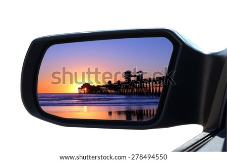 Car Mirror -  Sunset at the beach in car rearview mirror - stock photo
