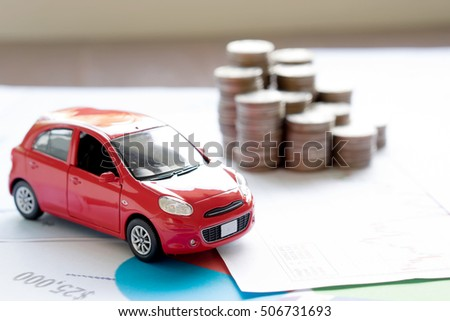 Car model and Financial statement with coins. (finance and car loan concept)