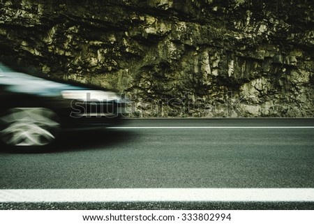 Car motion blurred, speed mountain road, highway - stock photo
