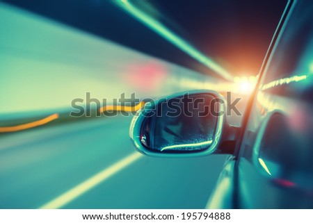 car moving fast in tunnel - stock photo