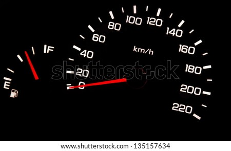 car odometer closeup in the darkness - stock photo
