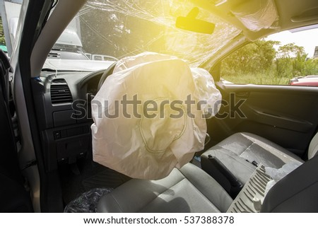 Car of accident make front windshield cracked and airbag explosion damaged at claim the insurance company. Working car repair  inspection at damaged of accident. image blur focus  style.