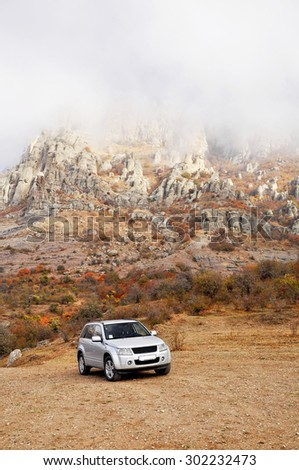 Car off-road on mountain background