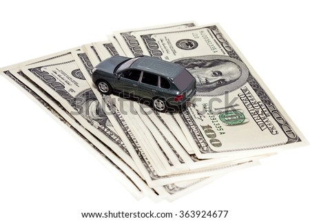 car on a hundred-dollar banknotes