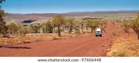 car on outback road - stock photo