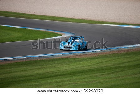 car on race track - stock photo