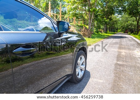 car on suburban road
