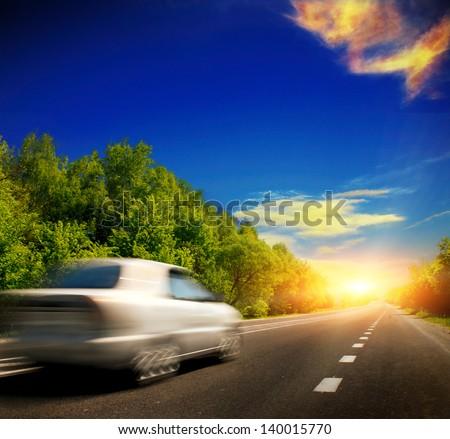 car on the asphalt road - stock photo
