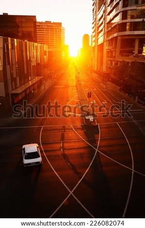 Car on the Bourke Street, Melbourne, at Sunset - stock photo
