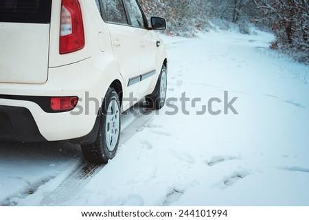 Car on winter road - stock photo