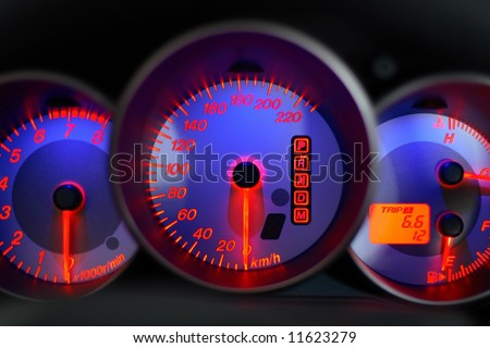 car panel instrument with blue speedometer and tachometer