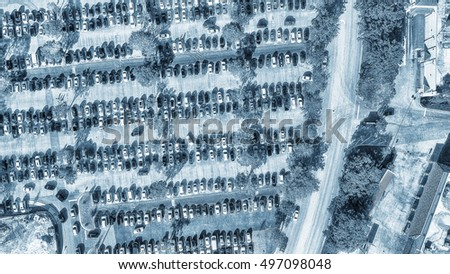 Car parking aerial view. Multiple rows of vehicles.