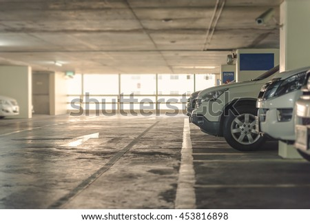 Car parking building with full of cars and column - stock photo