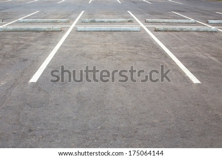 Car parking lot with white marks - stock photo