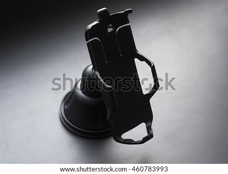 car phone holder on black background