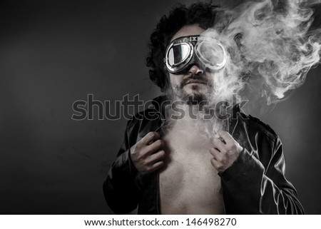 Car pilot with leather jacket and smoke coming out of your body heat concept, sexy anger - stock photo