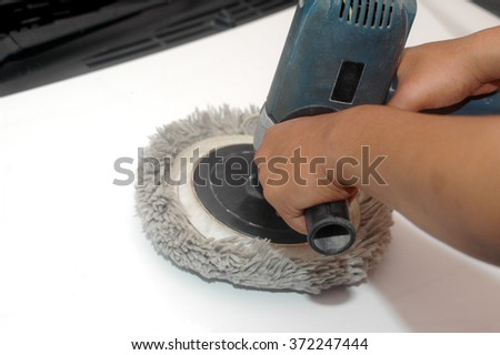 car polished by machine, hand held polishing machine - stock photo