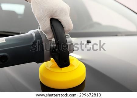 Car polishing - stock photo