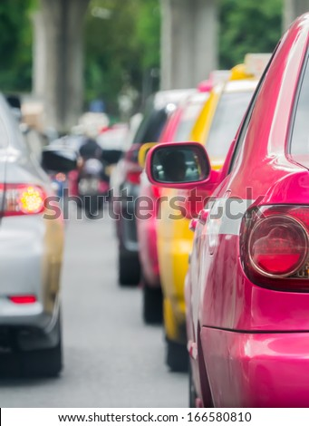 Car queue in the bad traffic road. Selective focus. - stock photo