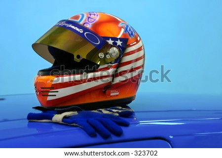 Car race helmet and gloves.