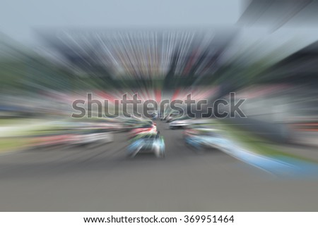 car racing on the road with motion blur background - stock photo