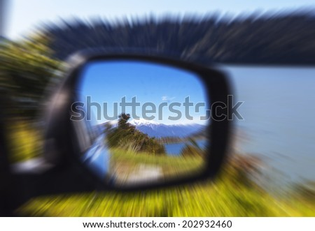 car rear view mirror speed motion effect - stock photo