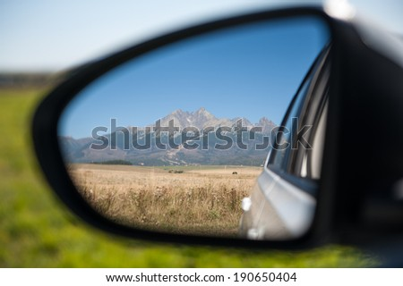 Car rear view of high mountains - stock photo