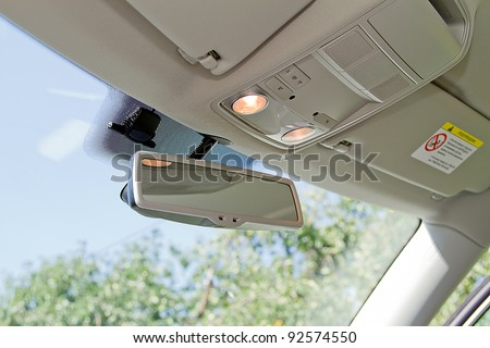 Car rearview mirror. Vehicle interio - stock photo